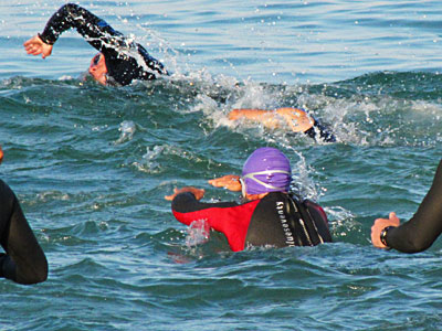 diving in (red wetsuit)