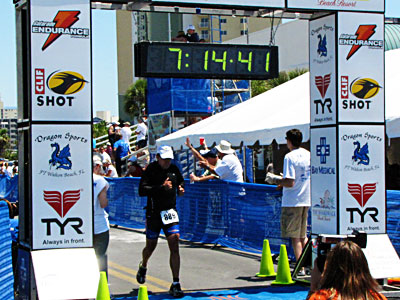that is 100% awesomeness crossing the finish line after a 13.1 mile run!