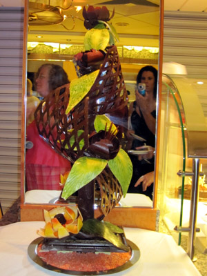 reflection of S taking pic of chocolate sculpture