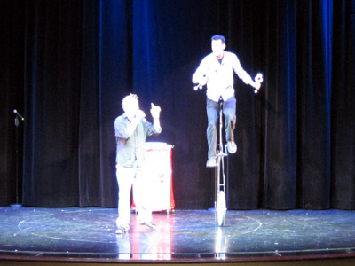 sharkbait finale - sean on a unicycle juggling the clubs as max tosses them